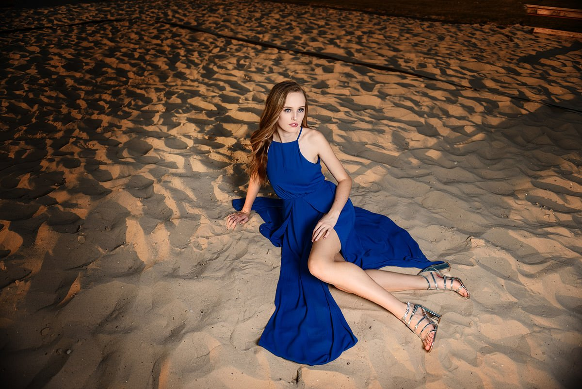 mckinney senior model in the sand in nice blue dress