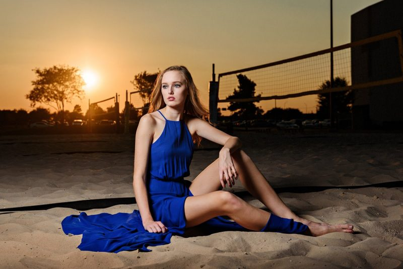 mckinney north sports junior volleyball in sand in prom dress