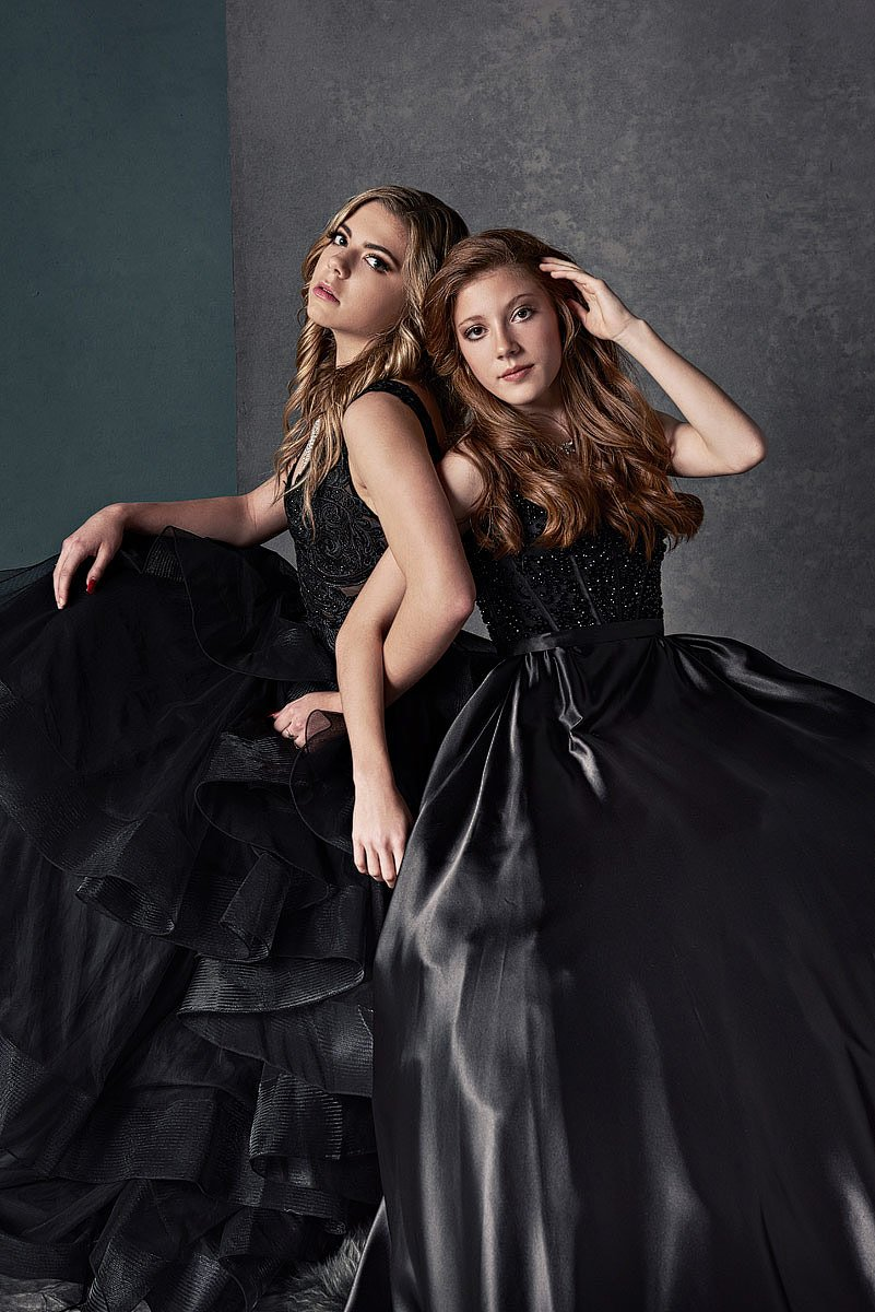 friends pose for dallas prom pictures in sherri hill and ellie wilde black dresses