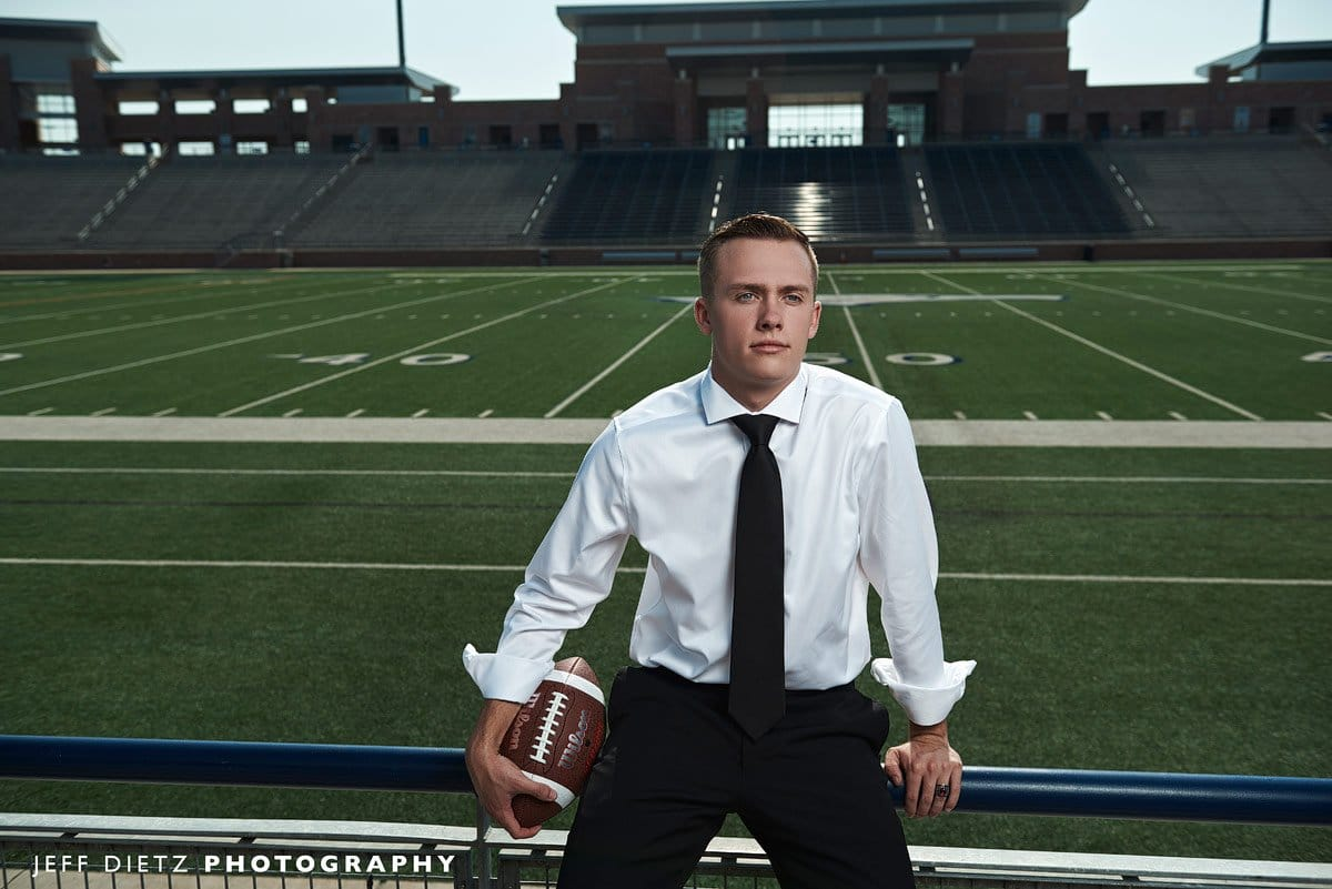allen senior photos at eagles stadium in the stands overlooking the field