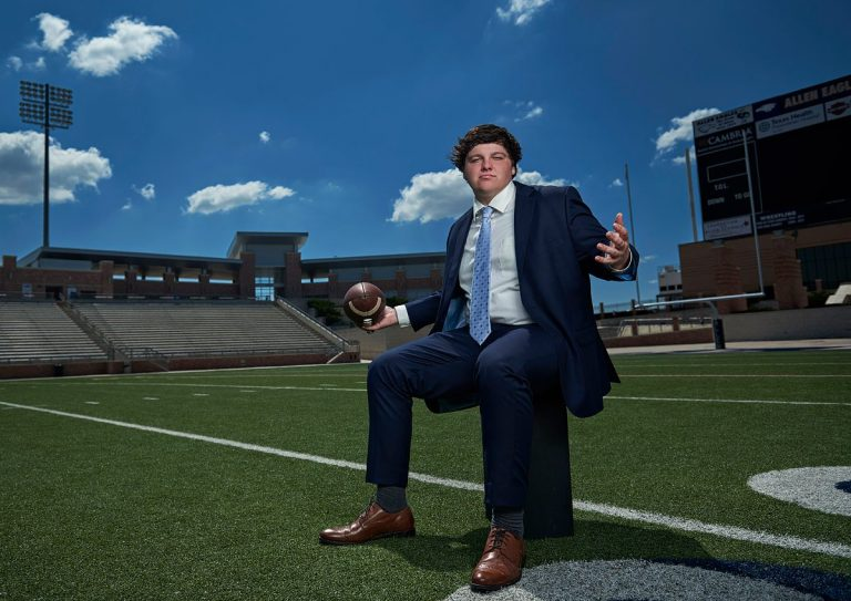 Allen football senior center for his senior portraits at eagles stadium