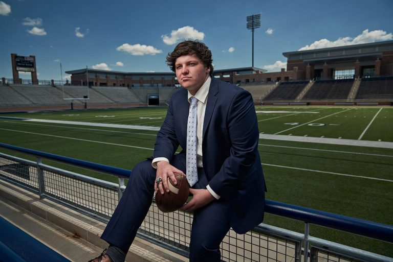 Allen Football center senior sports photos in suit at eagles stadium