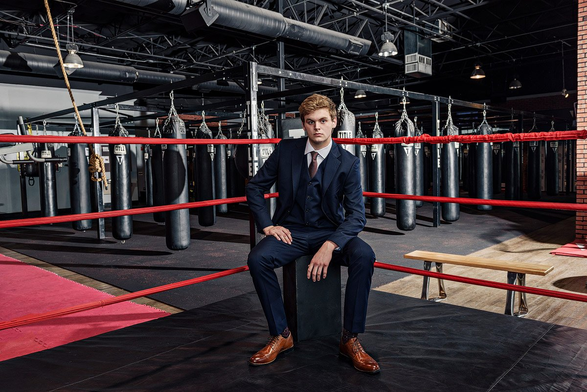 Plano senior portraits of student in a boxing gym in McKinney TX