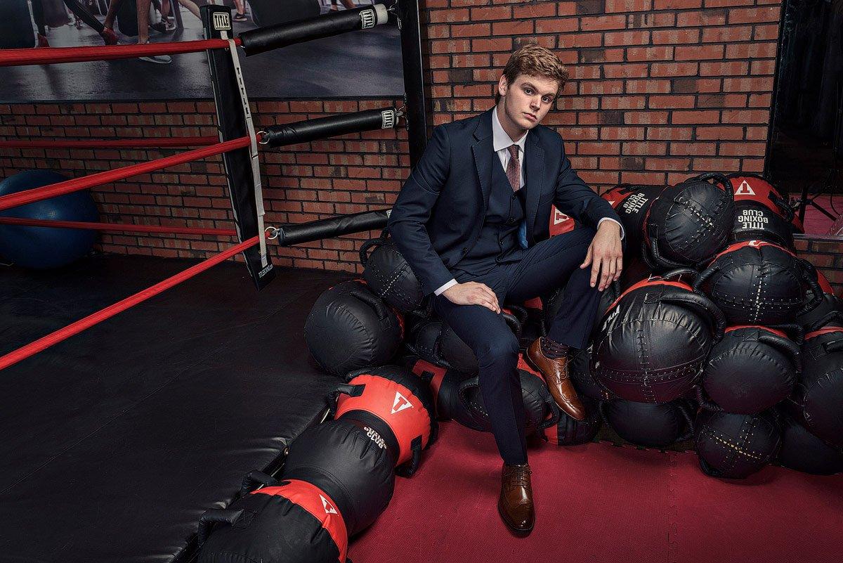 dallas senior portraits plano student in boxing gym in mckinney
