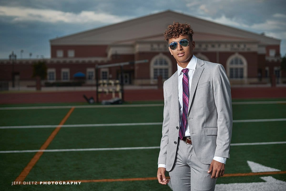 prosper senior photos with football player in sunglasses and suit