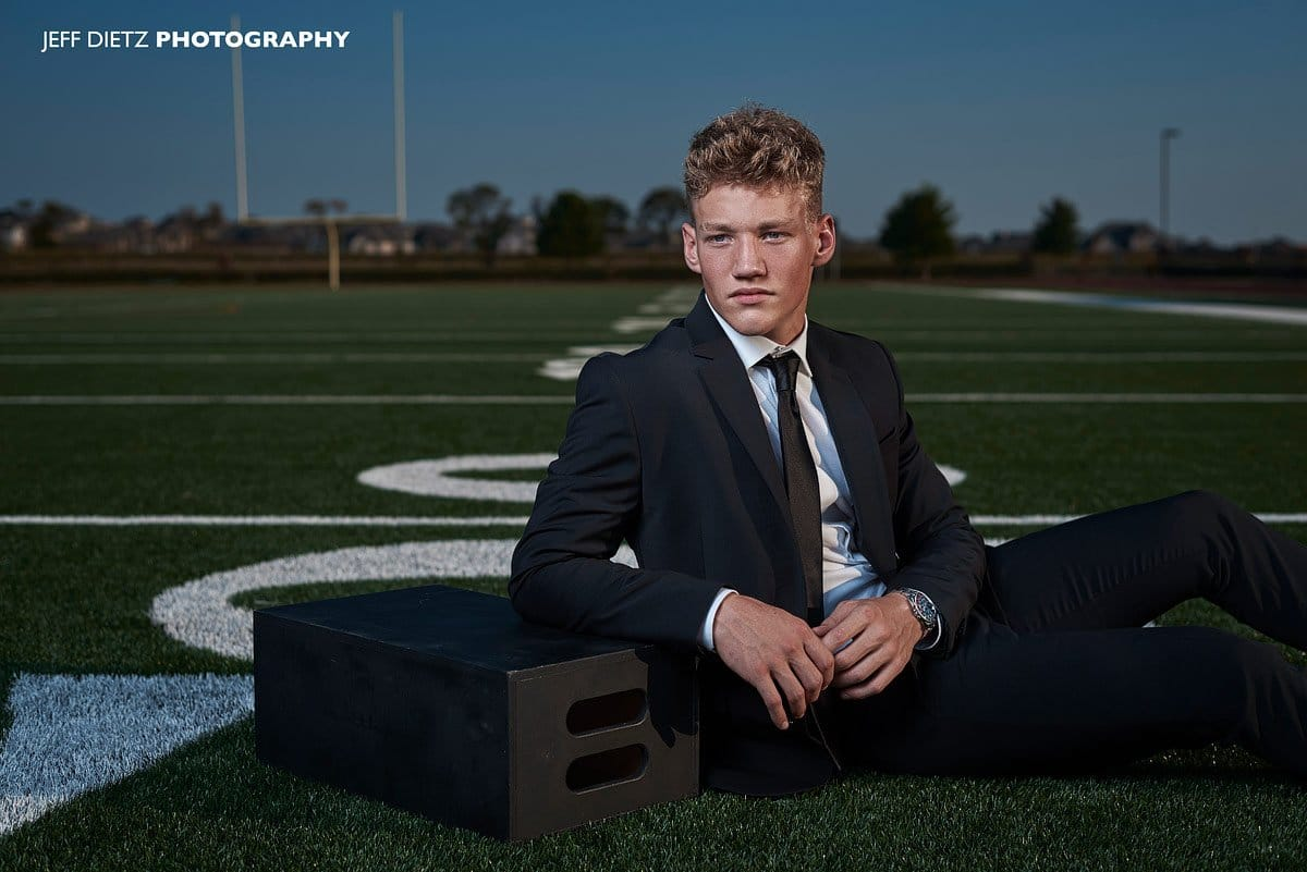Prosper editorial senior portraits of football player in fashion black suit