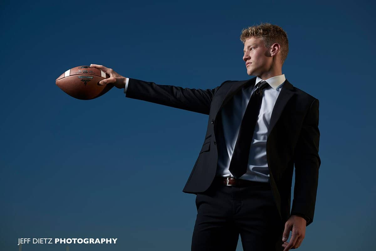 boys prosper senior portraits of football player in black suit