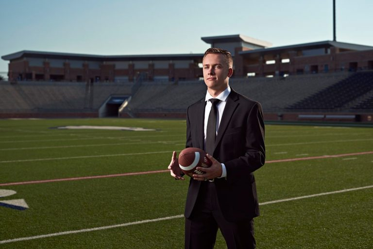 allen senior photos of football player in suit at eagles stadium