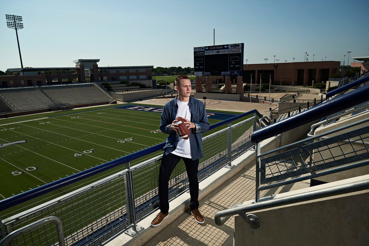 allen outside linebacker poses for senior portraits at eagles stadium
