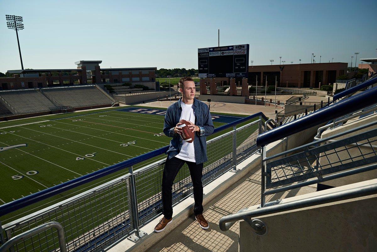 allen outside linebacker poses for senior portraits at eagles stadium