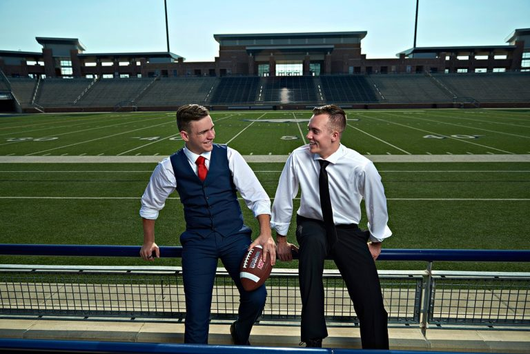 two allen football friends pose for fashion sports portraits at eagles stadium