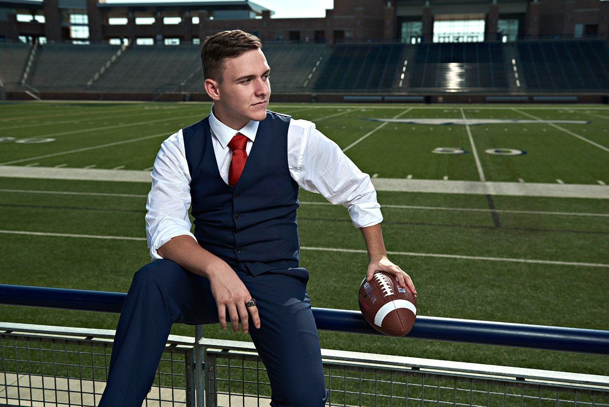 suit fashion allen senior portraits of football player in stands of eagles stadium