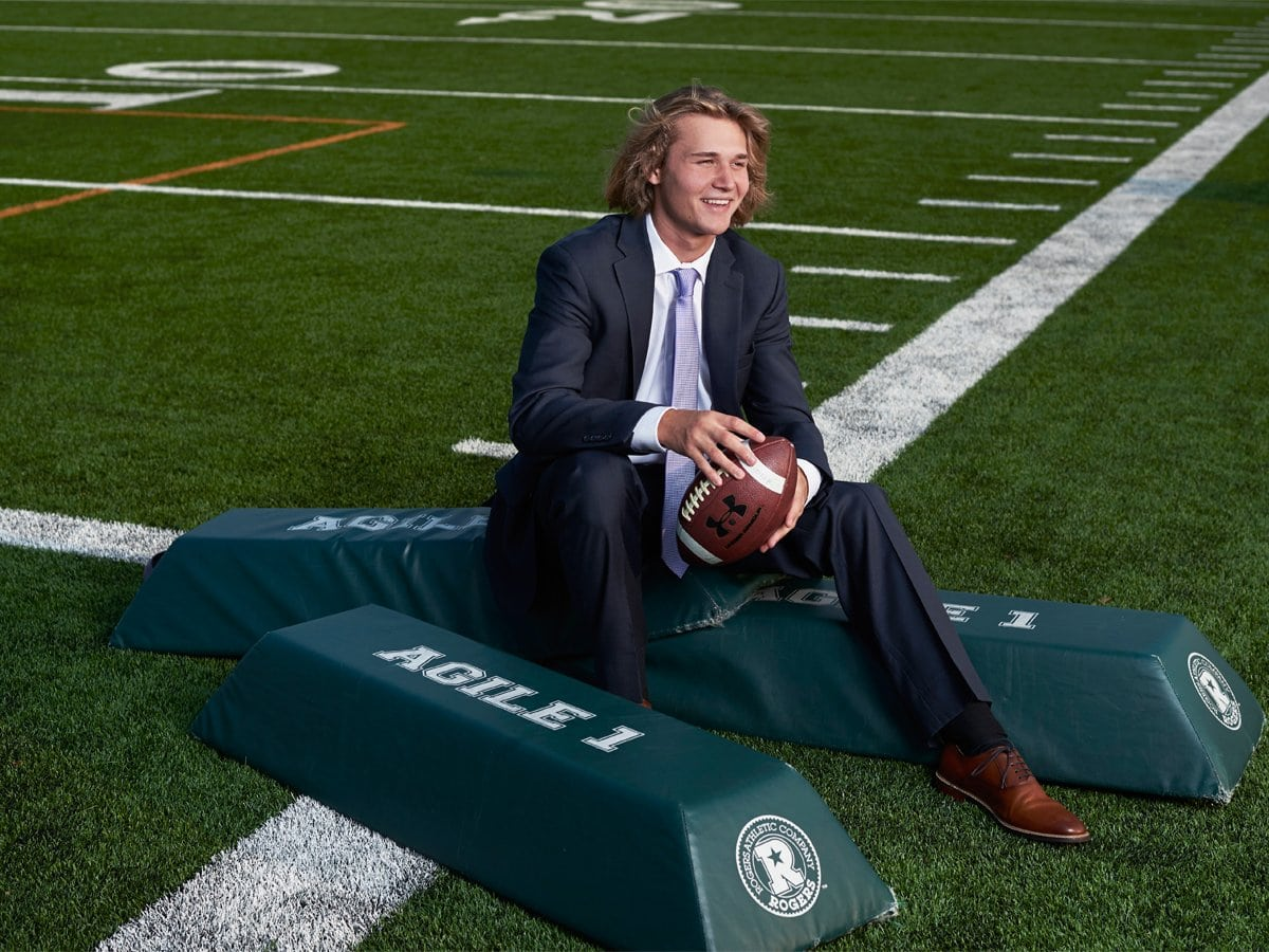 dallas sports portraits of senior prosper football player in a suit