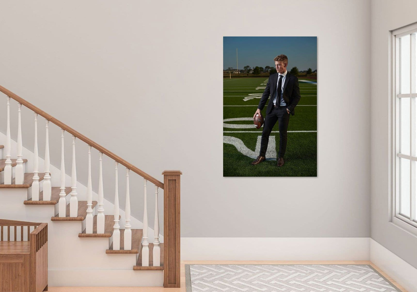 wall art of prosper senior portrait football player by stairwell