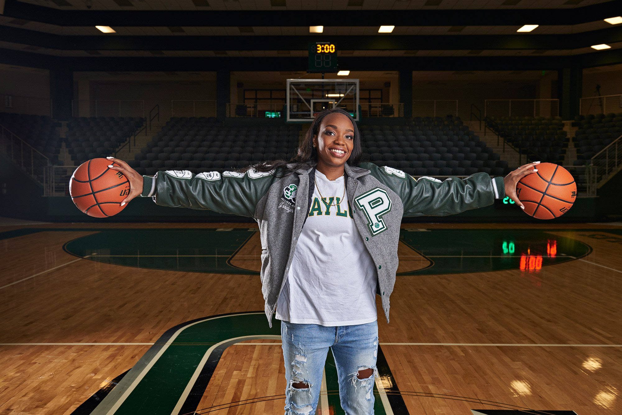 Jordyn Oliver palms two balls like MJ for basketball senior portraits at prosper tx