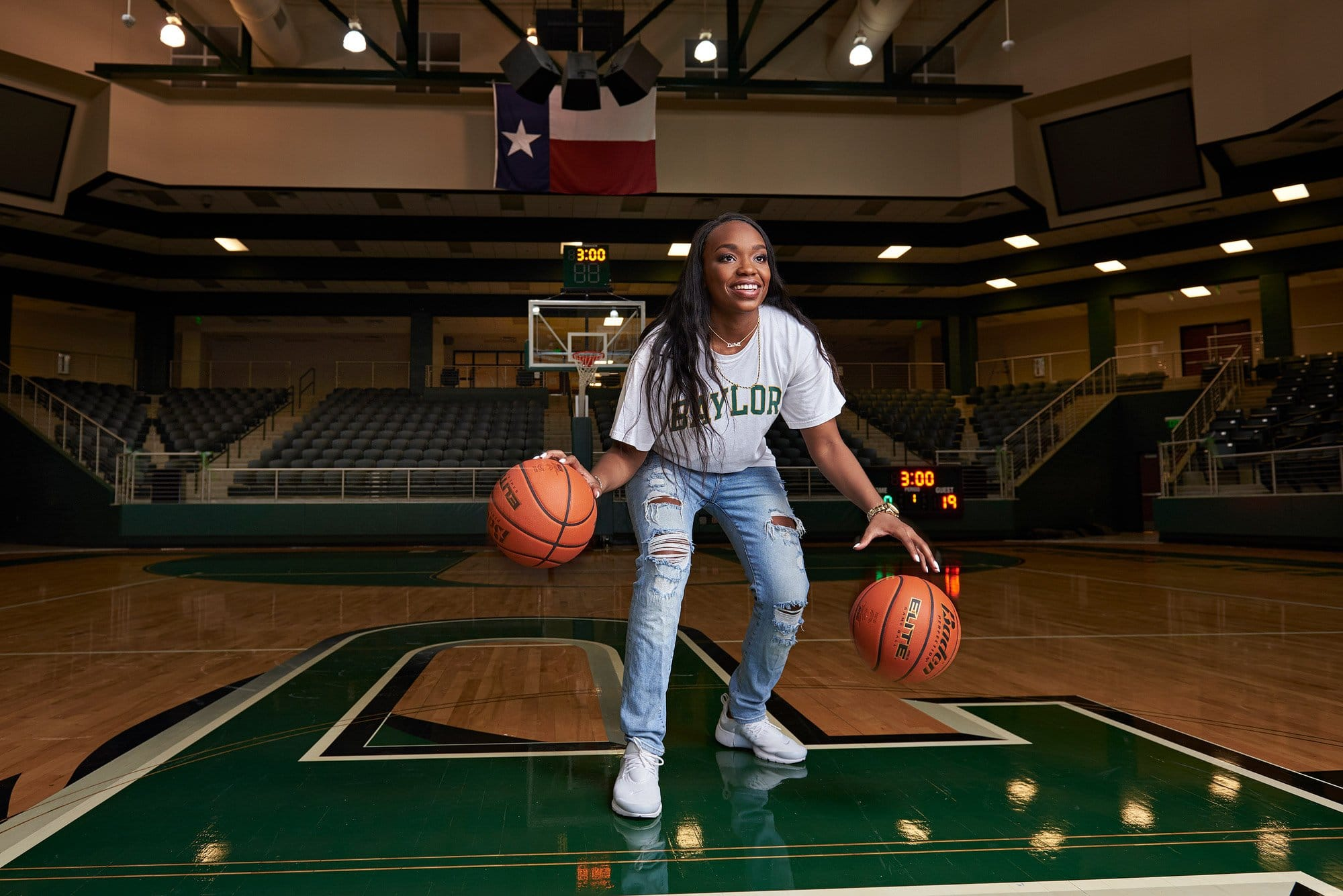 Baylor basketball commit Jordyn Oliver dribbles for Prosper senior photos with jeff dietz photography
