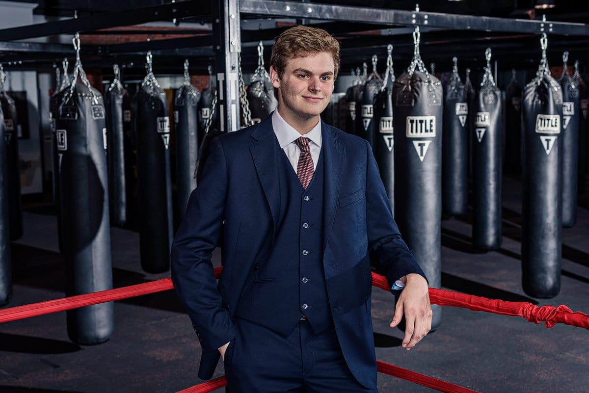 Plano east senior photographer poses in boxing gym for sports photos