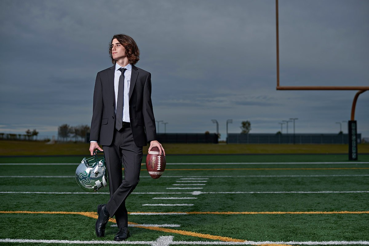 prosper senior photos with kicker football helmet and ball jeff dietz photography