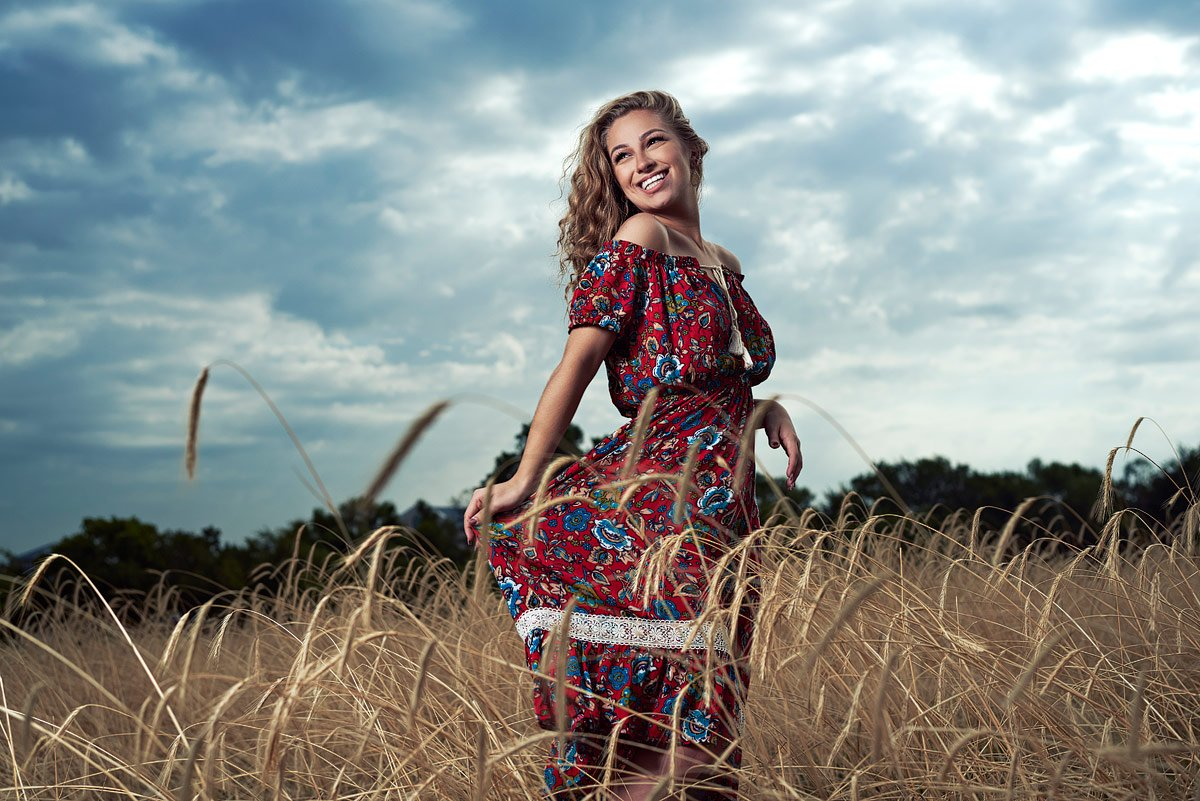Dallas Girls Senior Portraits fashion photographer in field red dress