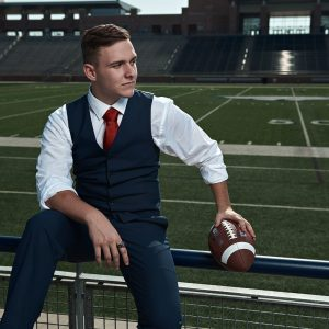 allen football player high school senior in a vest and tie for senior photos