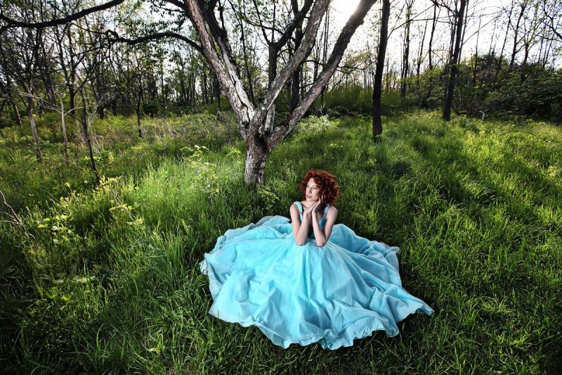 dallas senior girl wears teal prom gown in the woods for photos