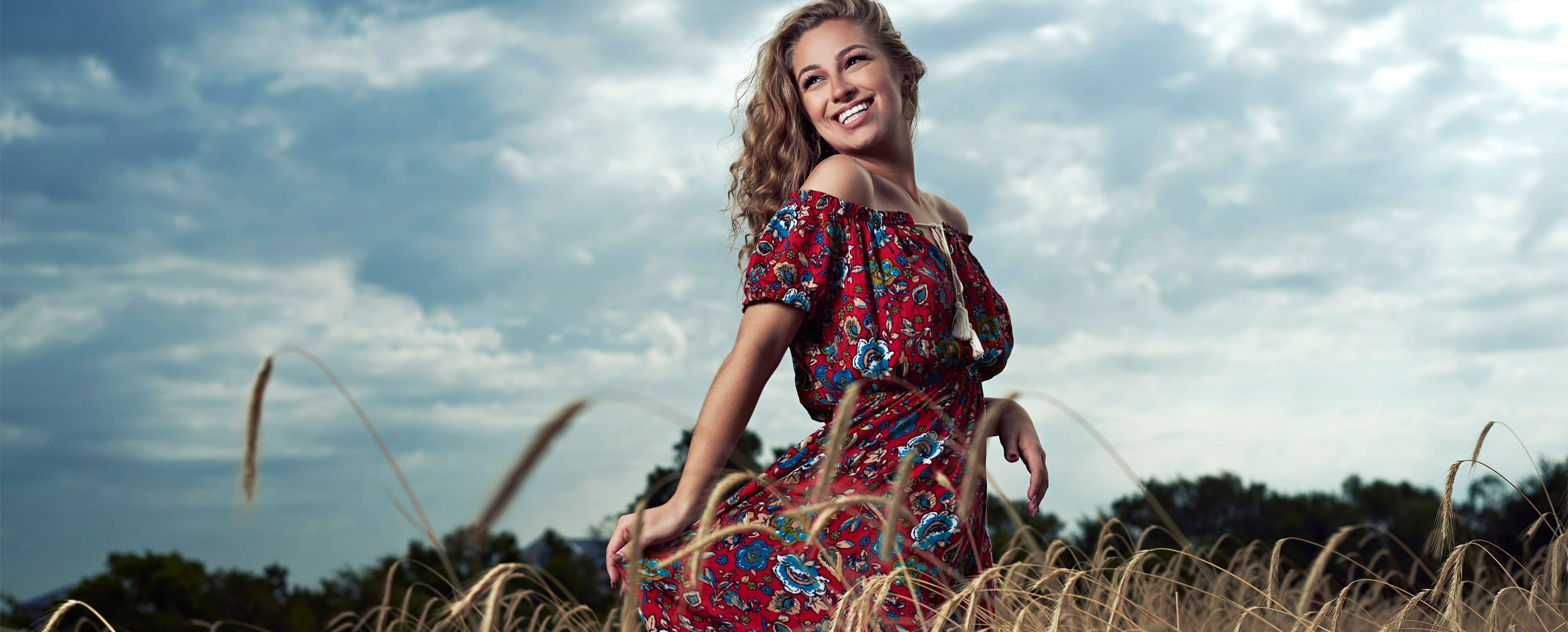 Dallas Girls Senior Portraits fashion photographer in field red dress