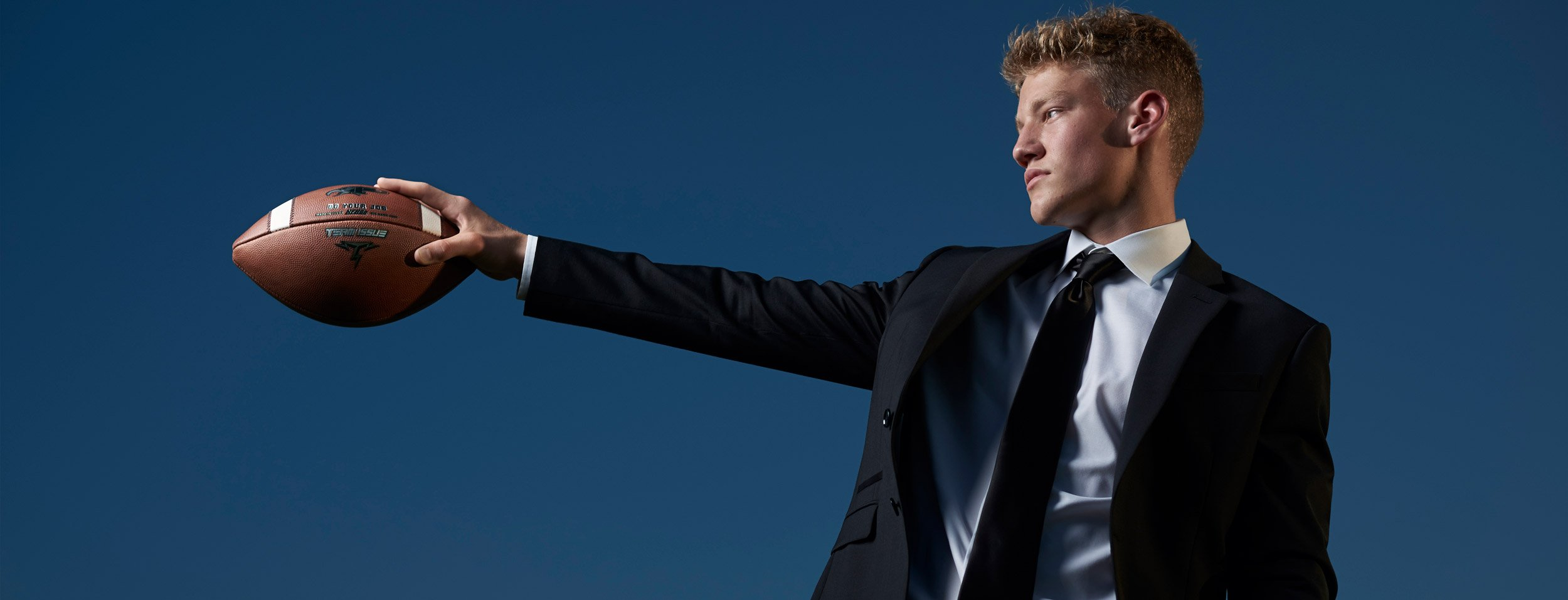 Dallas Sports Portraits from photographer Jeff Dietz of High School Athletes. Prosper football player in a black suit