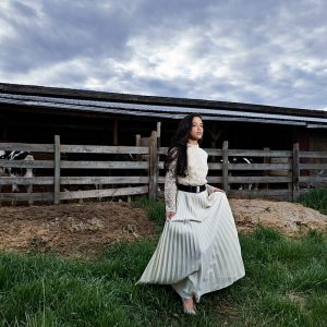 Farm senior portraits in mckinney of girl in white long dress