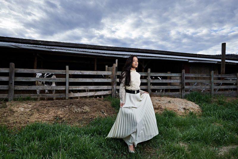 Farm senior portraits in mckinney of girl in white long dress