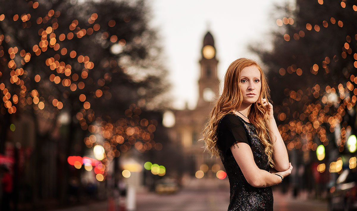 sundance square senior photos with christmas lights in background