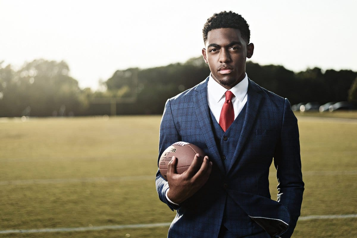 mckinney football player takes high school sports photos in a blue suit
