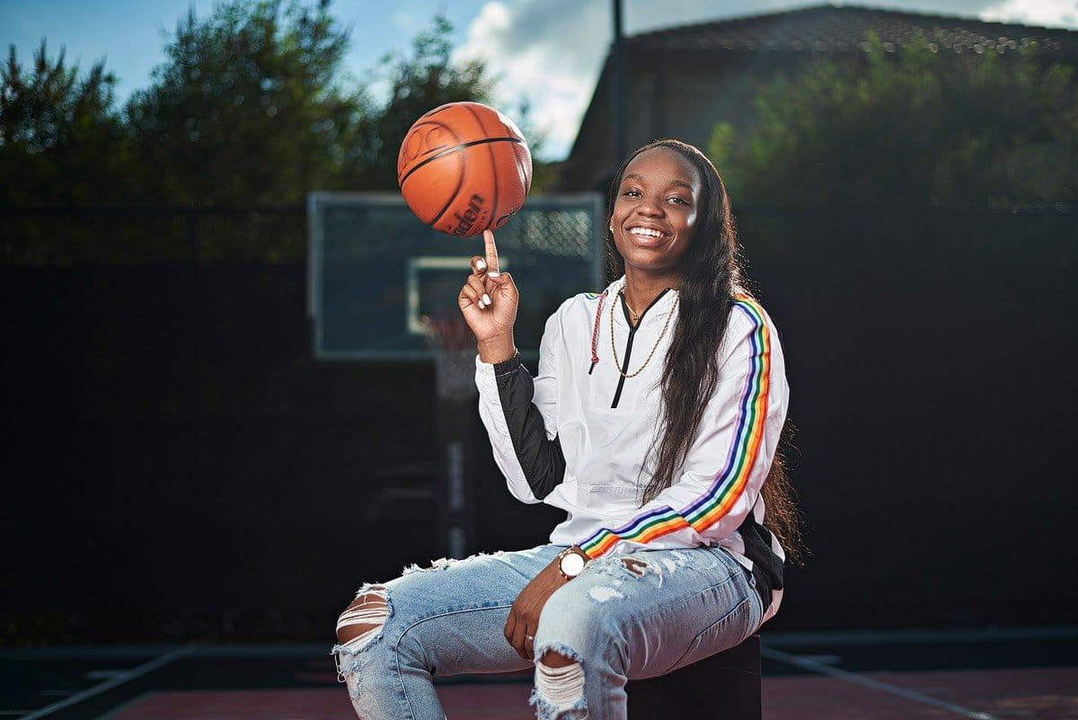 prosper girls basketball player spins ball on finger at outdoor court