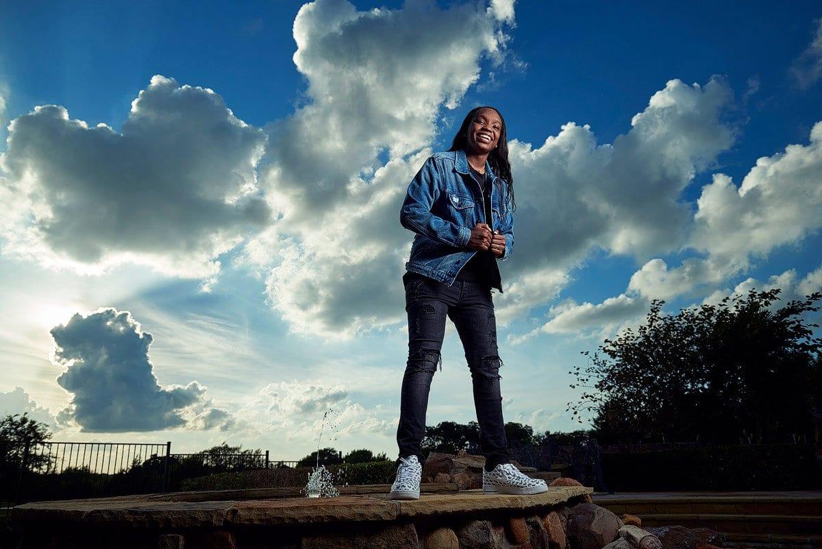 prosper basketball player Jordyn Oliver stand on top of rocks for senior pictures