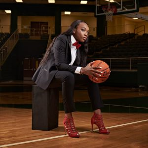 dallas girls basketball senior pictures on court in suit and heels