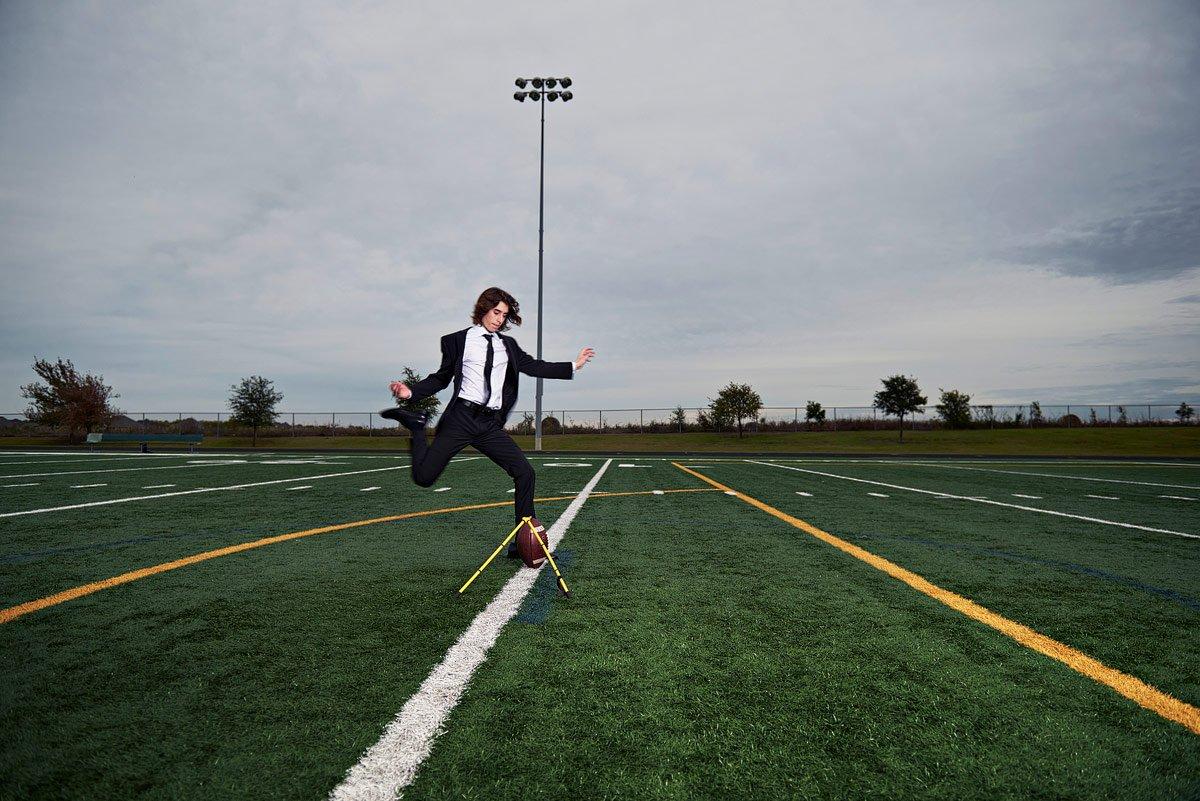 prosper kicker kicking field goal for senior portraits in suit