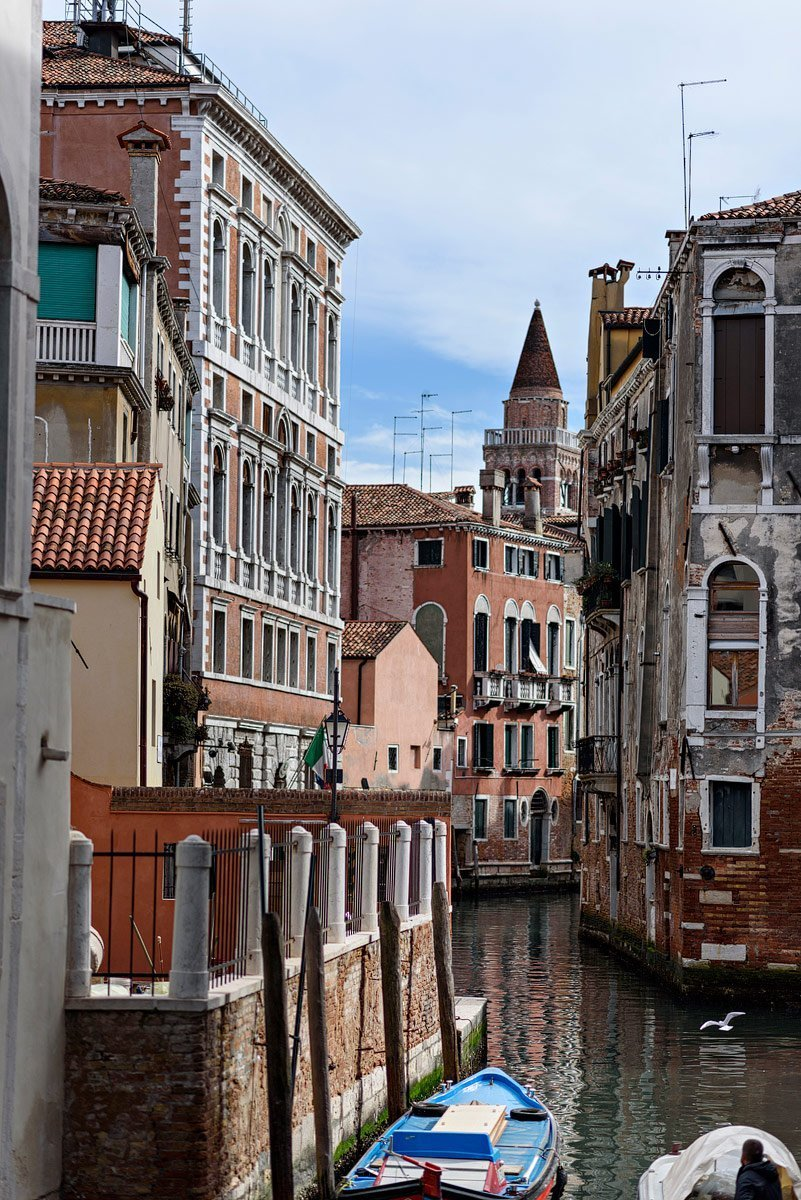 view of basilica from alley in venice italy