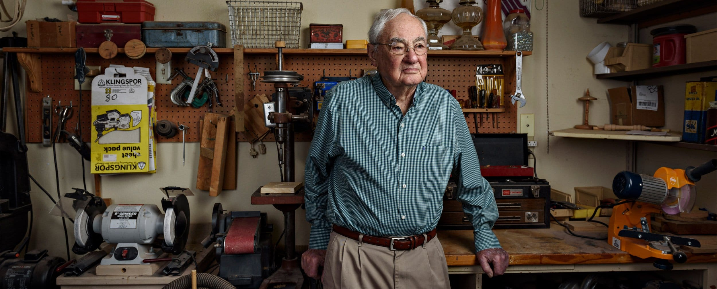 Dallas porrait artist photographs older man in wood shop in mckinney texas