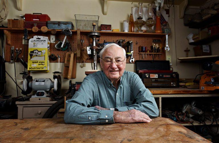 dallas portrait artist older man woodworking in shop mckinney texas