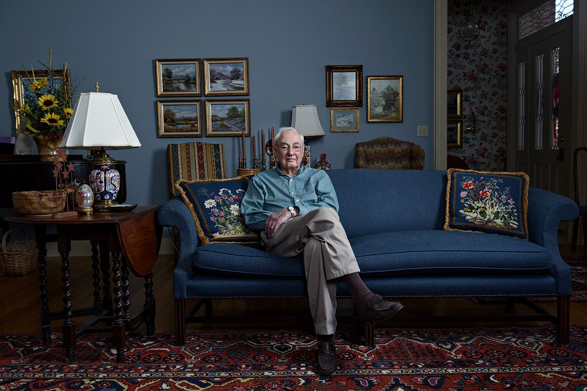 dallas portrait artist photographed older generation war veteran on couch in his home in mckinney texas