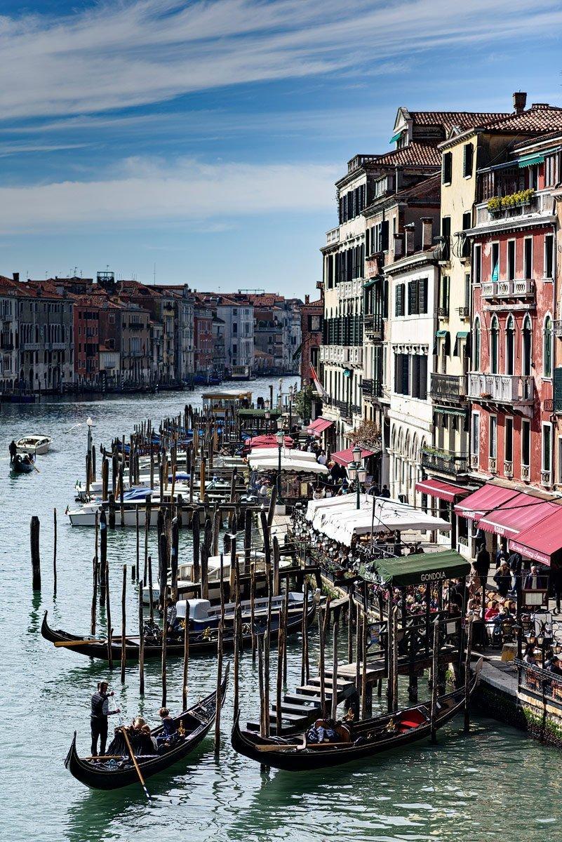 grand canal in venice italy gondolas leaving dock