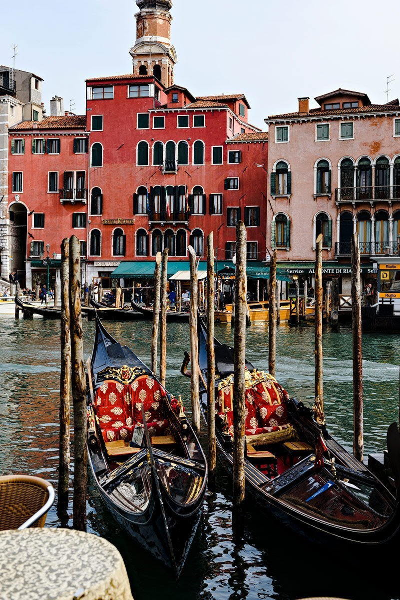 gondola's with red house in venice italy