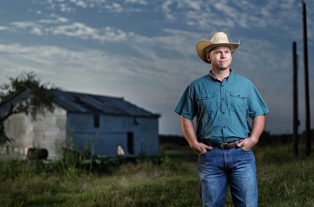 McKinney personal branding photographer of local yocal on a farm photos