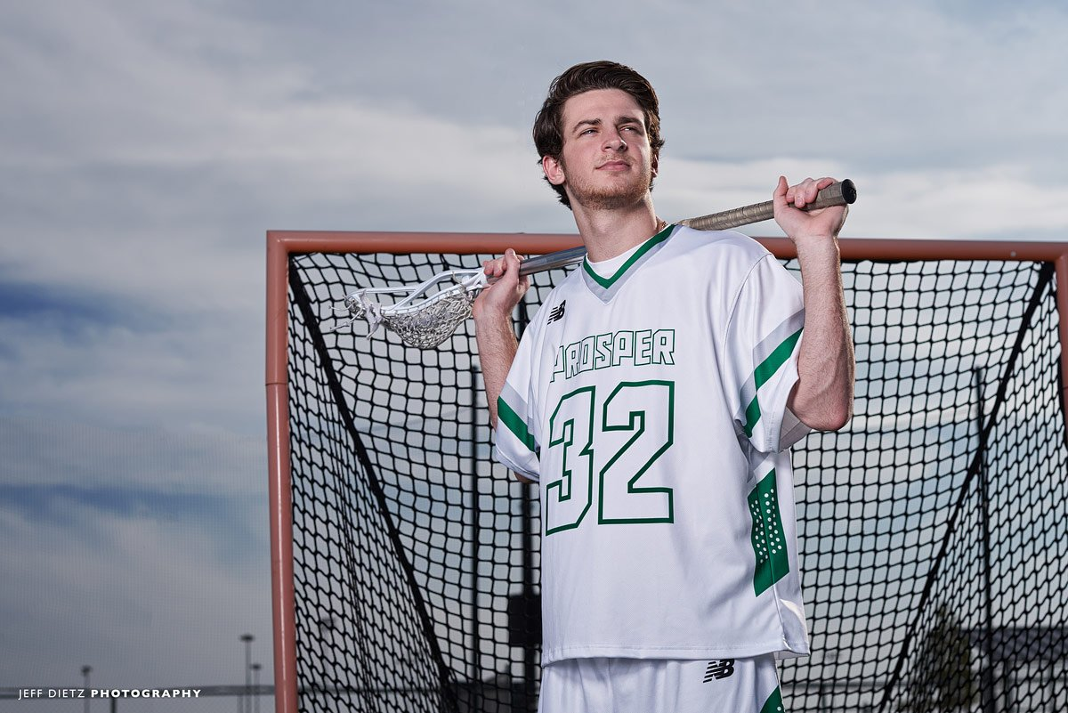 offensive #32 prosper lacrosse player by goal with stick for senior team photos