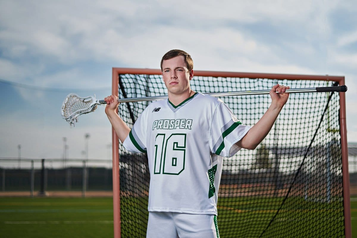 prosper lacrosse offensive player #16 poses for a portrait in front of the goal