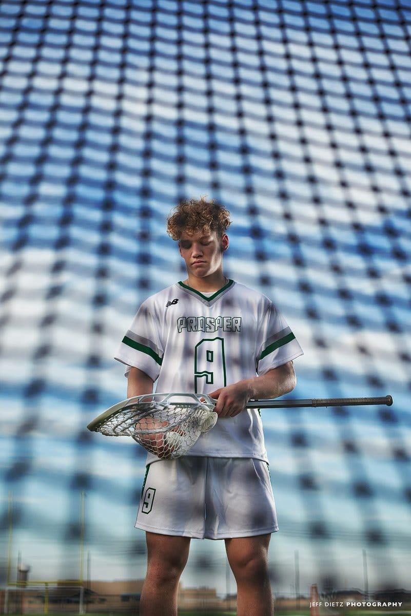creative lacrosse photo photographed through the net of prosper senior goalie
