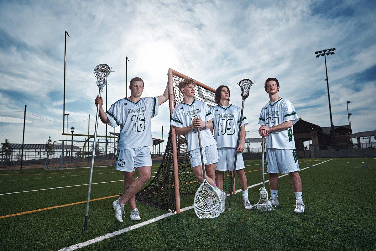 Prosper lacrosse team photo of senior members at pioneer park