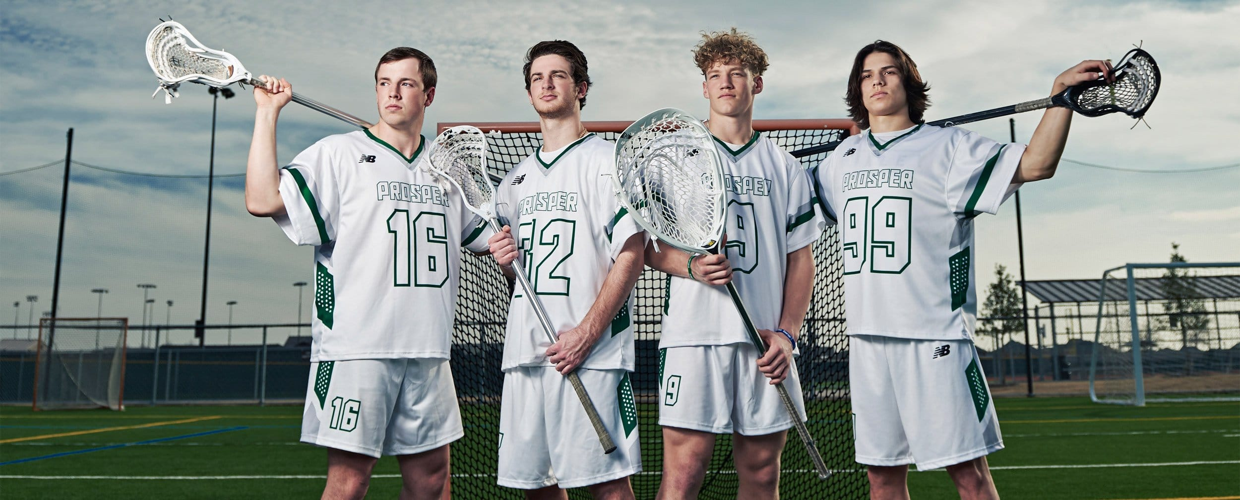 prosper lacrosse senior player with stick over shoulders and blue sky for team photos