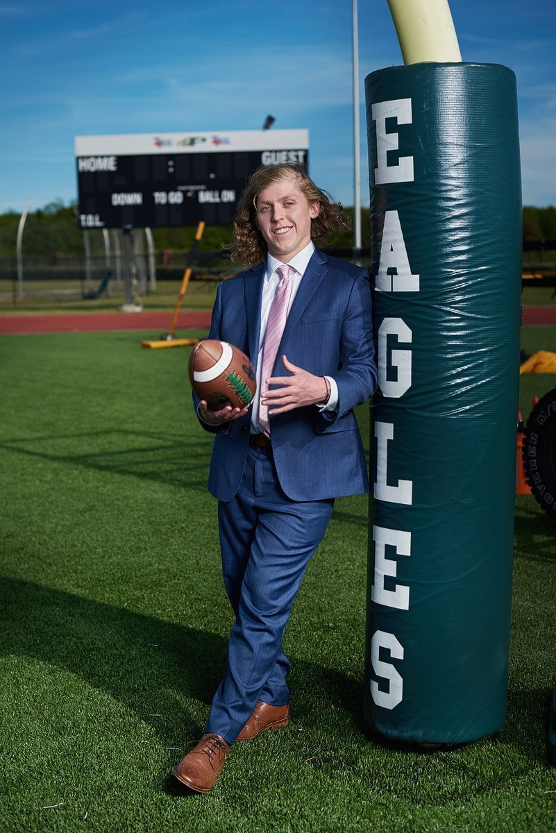 prosper senior next to eagles goal post on the practice field