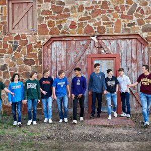 Prosper senior photos of boys college celebration t-shirts group pictures