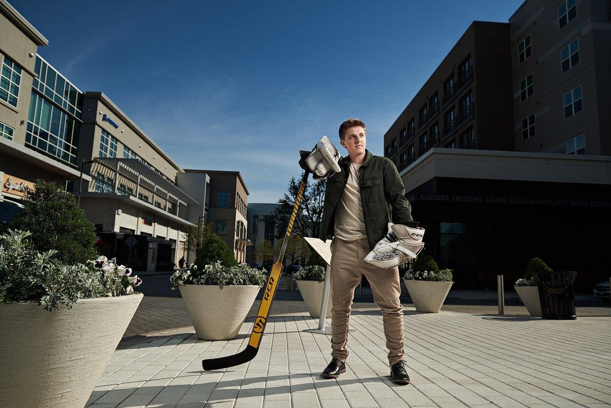 Mckinney Boyd Senior Portraits Hockey player in streets of legacy west